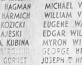 LASTING TRIBUTE: The names of 42 young men from Woodrow Wilson High School killed in World War II and the names of three who died in Vietnam are listed on the war memorial now adorning a wall at Wilson Middle School on Gibson Street.  Local Gold Star Mothers raised the money to build the memorial after World War II, and it was originally attached to Wilson High School which no long exists.