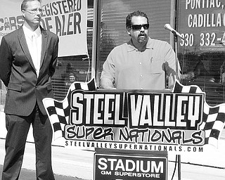UNHAPPY: Corey Ward, left, and his business partner, Brian Caiazza, express their displeasure about the nonrenewal of their popular Steel Valley Super Nationals at Quaker City Raceway, north of Salem. The pair learned through an announcement over the weekend that their contract was not being renewed.