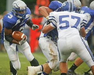 The Vindicator/Robert K. Yosay ----- FOLLOWING THE BLOCKER -   Hubbards #3 Andre Givens looks for  light as he follows  #52 Dan Moffitt into the Poland line - Poland defender  #57 David McLaughlin  is getting ready to stop him - 08272009
