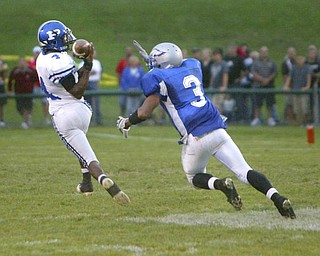 The Vindicator/Robert K. Yosay -----TD TD TD #4 Poland Darius Patton pulls in a huge pass in the first half of Hubbard vs Poland by beating the Hubbard defender #3 Andre Givens. - Darius went on to score - 08272009