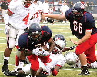 FITCH - CHANEY - (21) Bruce Reed of Fitch lounges in for a touchdown as (4) Breondrea Bunch and (7) Terrance Mackie watch the play during their game Friday night. - Special to The Vindicator/Nick Mays