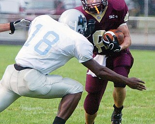 East's Anthony Carter tries to tackle Liberty's Brandon Martin during 1 rst qtr action friday @ Liberty. wd lewis