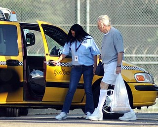Former Ohio congressman Jim Traficant, left, gets into a cab after being released from federal prison in Rochester, Minn., Wednesday, Sept. 2, 2009. Democrat  Traficant is ending a seven-year federal prison stay for accepting bribes and other corruption charges. (AP Photo/Craig Lassig)