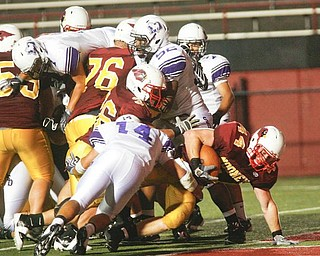 The Vindicator/Robert K. Yosay ---TD TD -  #44 Mark Brandenstein pushes thru the line #14 DeSales Nick Gentile trys to stop him but failed --942009