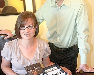 NEW BUSINESS: Jim and Amy Schneider show their new line of eyeglasses, Eyes of Faith. They are starting to market the line to independent eye-care professionals.