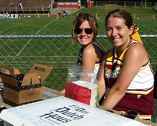 South Range senior cheerleaders Courtney Driscoll and Brittany Haynes sell refreshments at the JV game to raise money for the Pink Ribbon Classic.