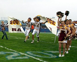 Jeff Baytos and Ron Lodge start the South Range football season by breaking throught the banner at Massilon Tuslaw.