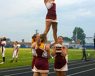 Senior cheerleaders Danielle Pendice, Jesse Heck, Courtney Driscoll, and Brittany Haynes cheer the South Range crowd on