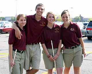 South Range Band Member Ethan Parks hangs out with friends Krista White, Rachel Lipp, and Emily Deiger as they wait to play at the Buddy Walk held recently at the Shops on Boardman Park.