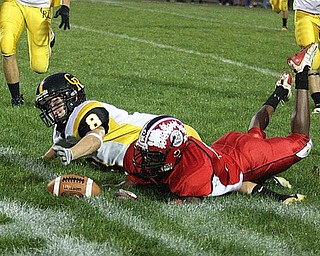 CRESTVIEW - COLUMBIANA - (32) Mardell Halas of Columbiana and (8) Jacob Danks fight for a lose ball during their game Friday night. - Special to The Vindicator/Nick Mays