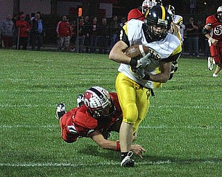 CRESTVIEW - COLUMBIANA - (9) Adam Britton makes the catch as (42) Jeff Davidson makes the tackle during their game Friday night. - Special to The Vindicator/Nick Mays