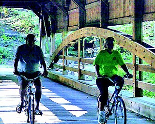 Tim and Ingrid Cassidy pedal over the bridge