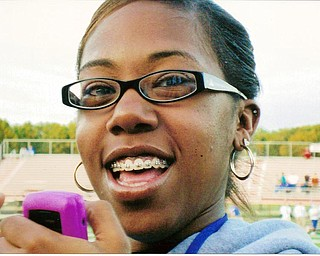 Fabulous Fan: Senior student, Summer Luckey, texting the game to a friend!