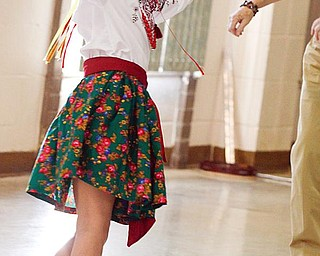 YOUTH MOVEMENT: Natalia Novicky, 7, of Austintown dances during the festivities at St. Anne Ukrainian Byzantine Catholic Church at the corner of Raccoon and Kirk roads in Austintown. Natalia was adopted from Ukraine four years ago by Dr. Dinah Fedyna.