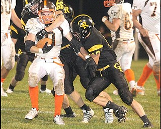 CRESTVIEW - EAST PALESTINE - The Crestview defense puts the stop on (9) Ryan Dilworth during their game Friday night. - Special to The Vindicator/Nick Mays
