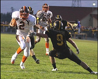 CRESTVIEW - EAST PALESTINE - (2) Shane Peterson gets away from (9) Adam Britton for a score during their game Friday night. - Special to The Vindicator/Nick Mays