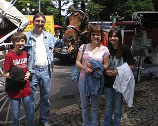 Eric and Melissa Pregi of Boardman and their children, Sean and Liana, have just finished a carriage ride in New York's Central Park.