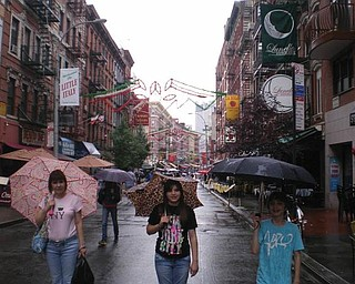 Melissa, Liana and Sean Pregi of Boardman stroll through Little Italy during a family vacation in New York.