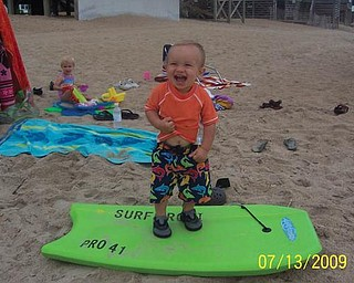 1-year-old Cooper Martz was 'surfing' in the Outer Banks.
