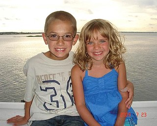 Michael Cougras, 8, and his sister, Connie, 6, of Poland are at the Chesapeake Bay at Ocean City, Md., in July.