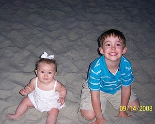 Here are Andrew Cvetkovic, 4 1/2, and his sister, Alexandra, 6 months, during their first visit to the beach in September at Myrtle Beach. They are the children of Nikki and Matthew Cvetkovic of Austintown.