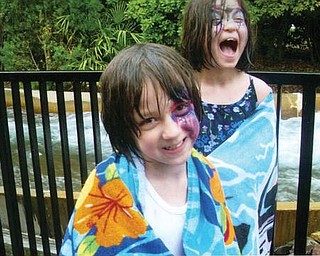 Autumn and Amber Murzda of Hubbard are enjoying there first water ride at Bush Gardens in July.