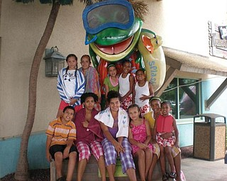 Top, from left, Aaliyah, Lilly ,Selena, Dawon and Rodney; and, bottom, from left, Tony, Elena, Jazmynlee, Briana, India and Giovanni are all enjoying their vacation at Splash Lagoon.