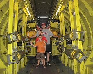 Joe, Alex and Anthony Weimer of Poland are inside an aircraft carrier at Wright Patterson Air Force Base in Cincinnati.