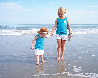 Karley, 4, and Kira 17 months, McAfoose, daughters of Kimberly and Gary McAfoose of McDonald, made their first trip to the ocean.