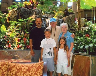 Jerry and Maryann Jurcisin of Coitsville Township celebrated their 50th wedding anniversary May 9 at Disney World in Florida with their son, Mark Yurcisin, and grandchildren, Andrew, 9 and Elizabeth, 8, of Reno, Nev.