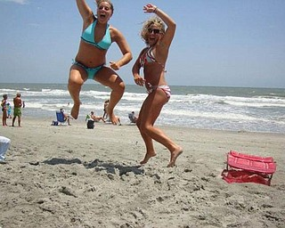 Tricia Bettura , left, Rachel Melewski of Canfield are jumping with joy at Myrtle Beach!