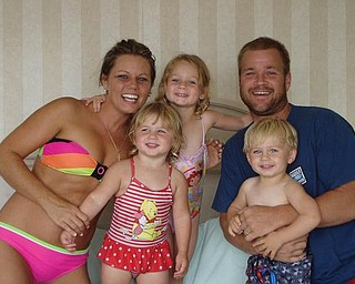 On their first family vacation in August in Ocean City, Md., are Brandon and Jackie Bower of Austintown and their children, Brelyn, 4, and Kaelyn and Hadyn, 2.