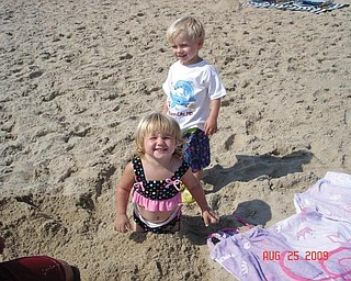 Kaelyn and Hadyn Bower, 2, children of Brandon and Jackie Bower of Austintown, enjoy their first trip to the beach at Ocean City, Md.
