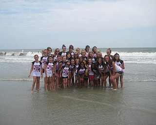 Members of Jamie's Dance Force Competition Team were in Myrtle Beach in July. They took time out from competing at the Starpower National Talent Competition to make some memories on the beach. Studio owner and director Jamie Cordon is in the center of the back row.