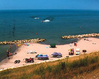 Vacationers are having fun at a new beach on Olive Drive, Saybrook, at Lake Erie. Photo provided by Howard and Suzie Hallas of Poland.