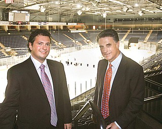 ALL IN THE FAMILY: Alex Zoldan, president of the Youngstown Phantoms hockey team, left, joins his father, Bruce Zoldan, owner of the team, at the Covelli Centre. The junior hockey league team's season opener is Saturday at the Youngstown arena.