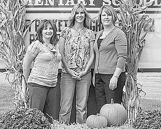 Special to The Vindicator HARVEST SPECIAL: Among those who have completed arrangements for a fall festival, which will benefit Lloyd Elemenatary School and its students, are, from left, Jenn Kluchar, committee cochair; Kelly Constance, festival chair; and Kim Smrek, committee member.