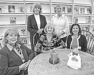 <p>PARTY PLANNERS: Satisfied with final preparations for a major fundraising event to be sponsored by Youngstown Federation of Women's Clubs are, from left, Barbara Higgins, Marylou Stimple, Suzanne Brown, Rusti Puromaki, and Debra Kostelic, club members.</p>