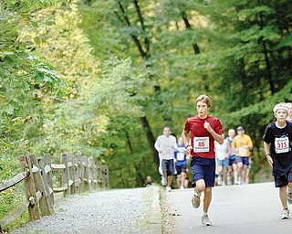 The Vindicator/Geoffrey HauschildAlan Burns, age 13 of Boardman, and  Zach Stamp, age 12 of Boardman, run through Mill Creek Metro Park during the Peace Race on Sunday morning.
