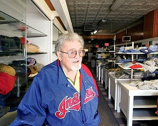MEMORIES: Nick Noviello shares some of his memories in the  Bridge Street store in Struthers where he's worked for 60 years. The store and its inventory will be auctioned Thursday.