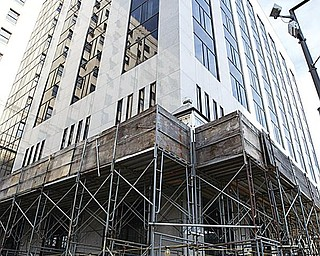 RENOVATIONS: Scaffolding is set up outside the National City building in downtown Youngstown. National City Bank was bought out by PNC Bank last year, and the building's signage is scheduled to be replaced in the coming months.