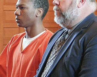 LIFE IN PRISON: Eugene Cumberbatch appeared in Trumbull County Common Pleas Court with his attorney, Joseph Fritz, to be sentenced for his role in the April 13 deaths of Lloyd McCoy Jr., 11, and Marvin Chaney, 26. Cumberbatch was sentenced to life in prison with parole eligibility after 38 years.