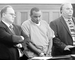 ACCUSED OF DOUBLE MURDER: Lorenza I. Barnette, center, charged with two counts of aggravated murder, two counts of kidnapping, two counts of aggravated robbery, and arson, enters a plea of innocent Tuesday to those charges in Mahoning County Common Pleas Court. He is flanked by his attorneys Paul C. Conn, left, and Thomas E. Zena.