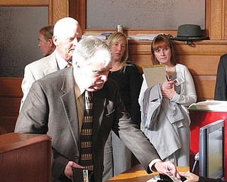 ONE MORE CHANCE: Tom Mahoney, former Trumbull County Department of Job and Family Services director, hands the bailiff his driver's license in Trumbull County Common Pleas Court. Judge John M. Stuard sentenced Mahoney to four years' probation for his conviction on a cocaine-possession charge.