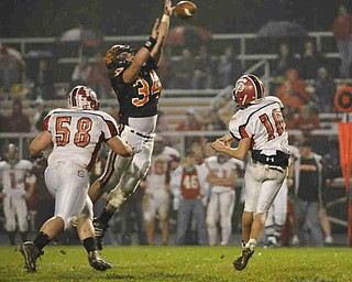 Springfield's (34) Dylan DeJane  blocks Columbiana QB Austin Barbato's pass on Friday night. Photo/Mark Stahl