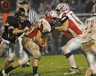 Columbiana's RB (22) Nick MacMillan gets some tough yards against Sprinfield during their game on Friday night. Photo/Mark Stahl
