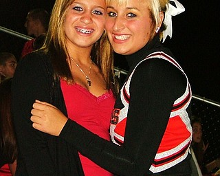 Sisters and best friends, Paige Baker and varsity football cheerleader, Morgan Baker, get together during halftime of the Dover game to hangout.
