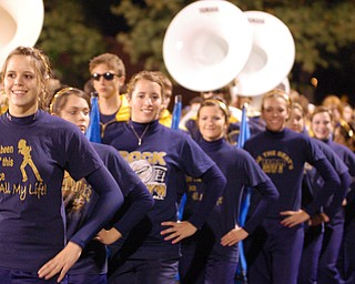 The Lowellville danceline and marching band comes off the field after the halftime performance at Sebring.