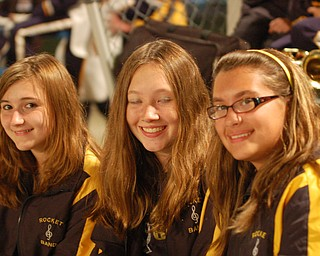 Krista Romano, Kayla Theiser and Antonina Boggia relax after the halftime performance of the Lowellville marching band at the Lowellville/Jackson Milton game.
