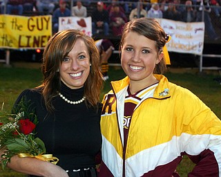 """""""Jesse Heck poses with fellow South Range cheerleader Dominique Bishop who had the night off from cheering to be on 2009 Football Homecoming Court."""""""